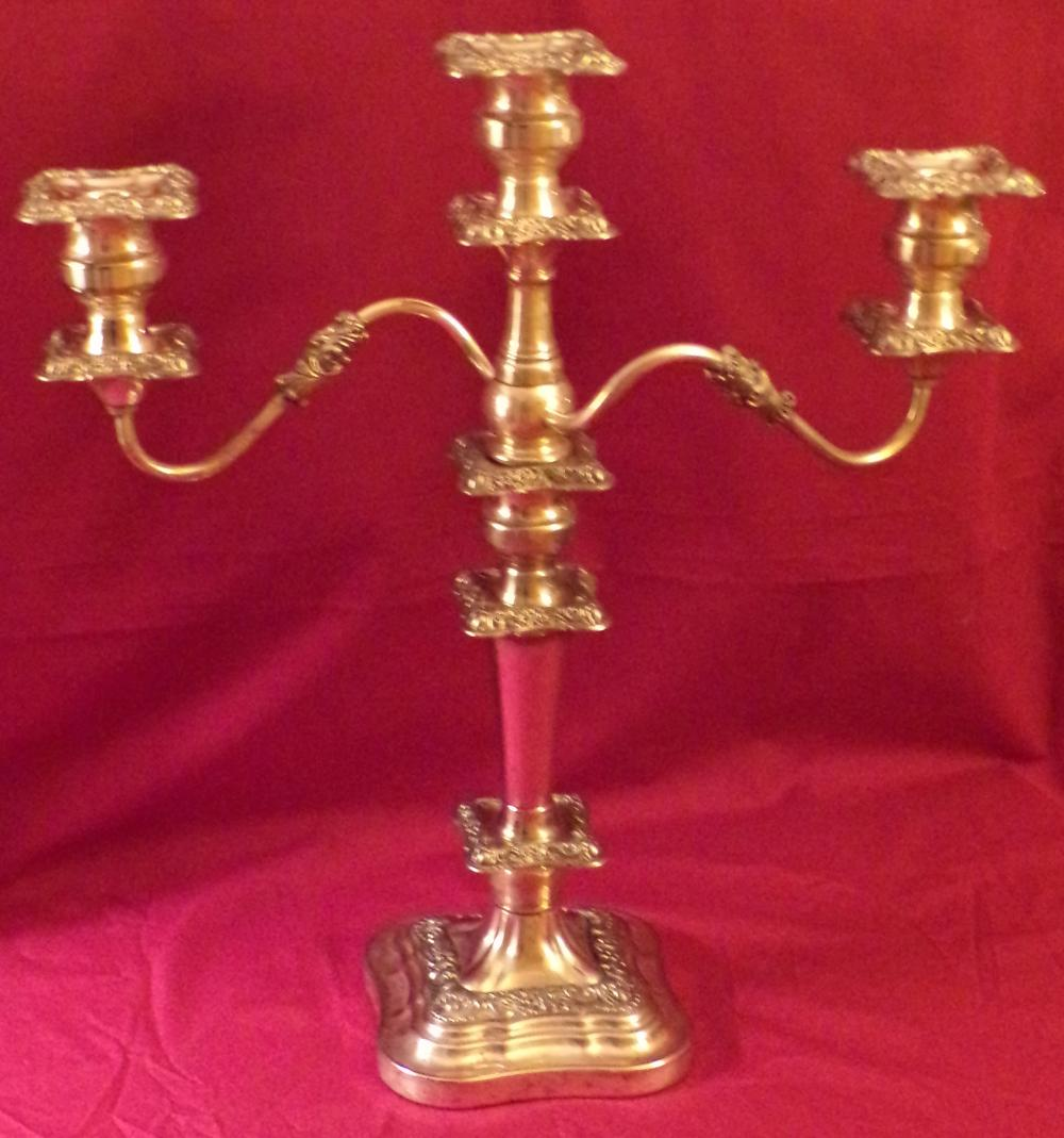 Pair of older matching plated silver candelabra, leaf design, each having a center stick with 2 branches, tapered base column on square bases, crown & SCEP touchmarks, interior rim center column of 1 stick partially missing, bobaches