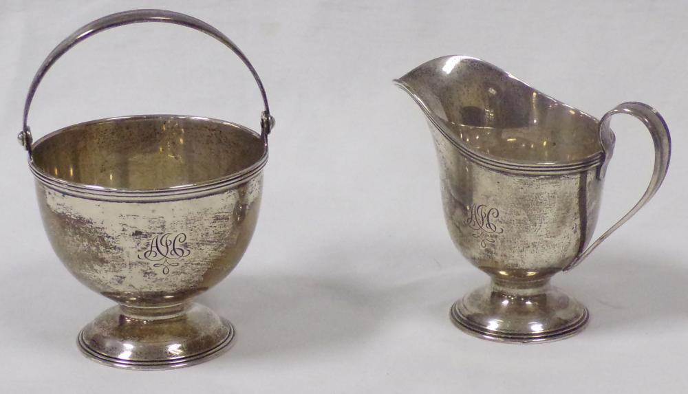 Sterling silver creamer & sugar set marked Tiffany Co. Makers, monogrammed; creamer- 3 ¾'' T, sugar with handle - 5 ¼ T