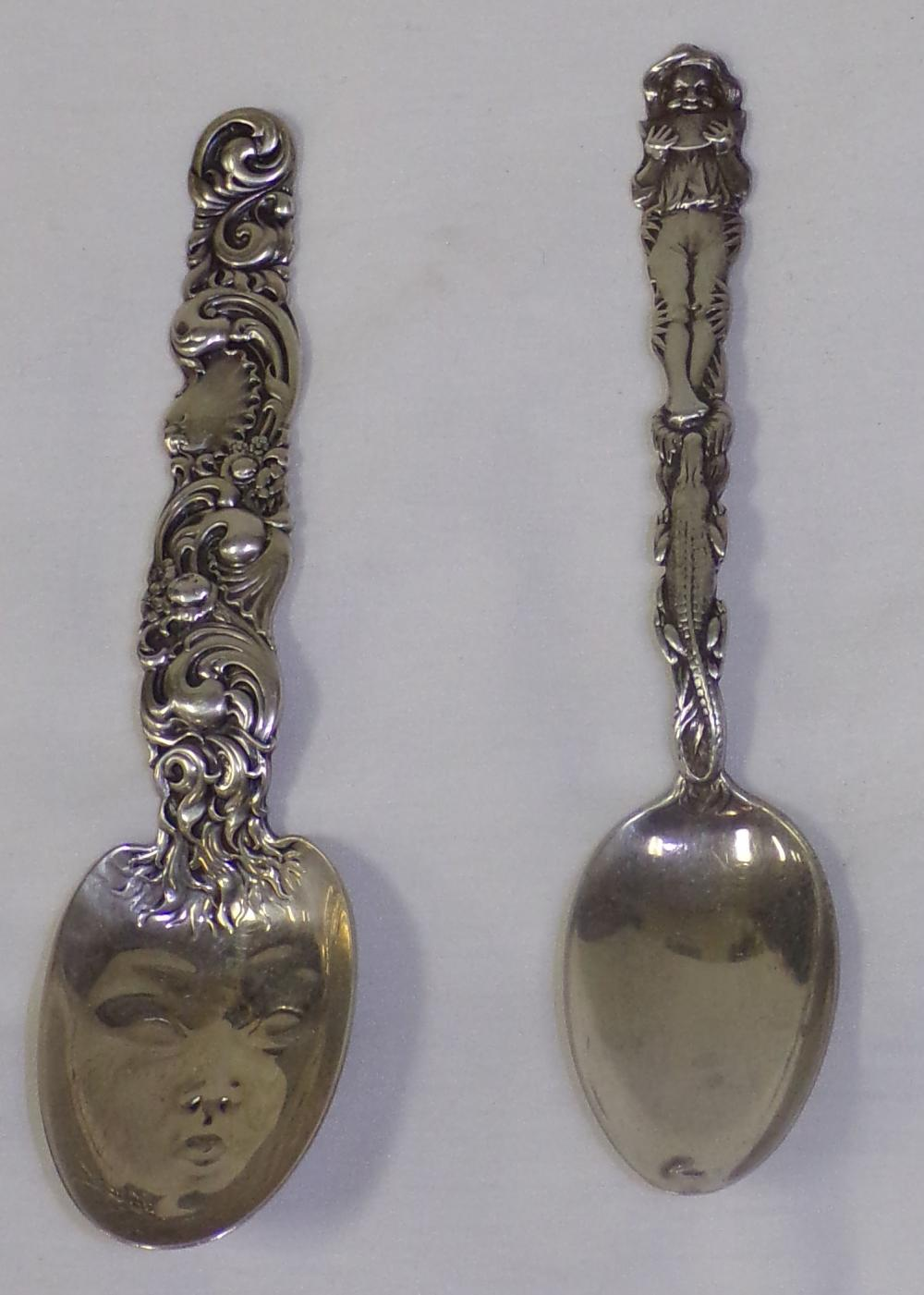 "(2) sterling silver spoons, 1 with ornate handle & face formed bowl – 6"" L AND 1 with handle decorated with a person  eating a melon – 5 3/"" L"
