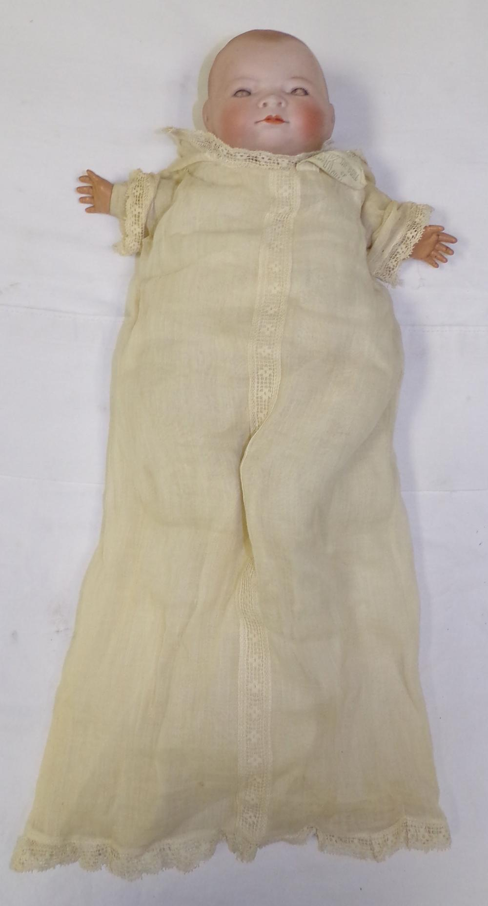 Vintage Bi-Lo type bisque head baby doll dressed in night gown having composition hands, cloth legs & feet, marked Grace Putnam, Made in Germany approx. 11'' L