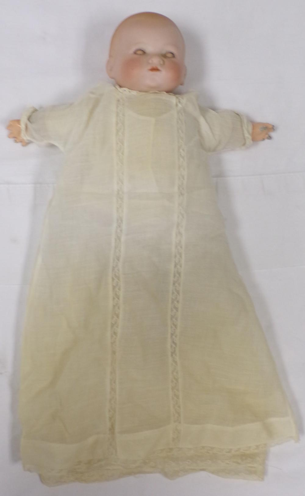 Vintage Bi-Lo type bisque head baby doll dressed in night gown having composition hands, cloth legs & feet, marked A.M. 341/8, fingers worn, approx. 13'' L