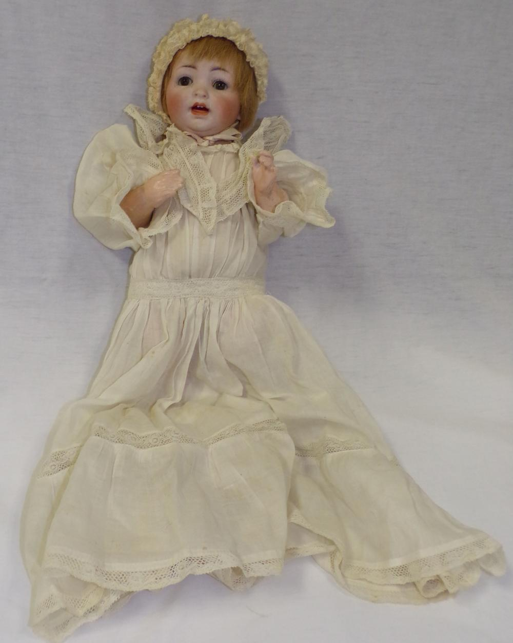 Vintage bisque head doll with jointed composition body dressed in lace dress & cap, marked Made in Germany #152/4, composition legs showing wear & line crack, approx. 13'' L