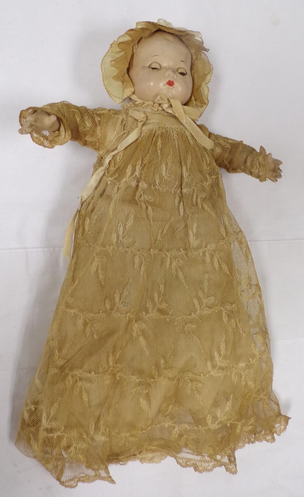 Composition doll marked Alexander in lace bonnet & dress having a jointed body, some crazing on legs,
