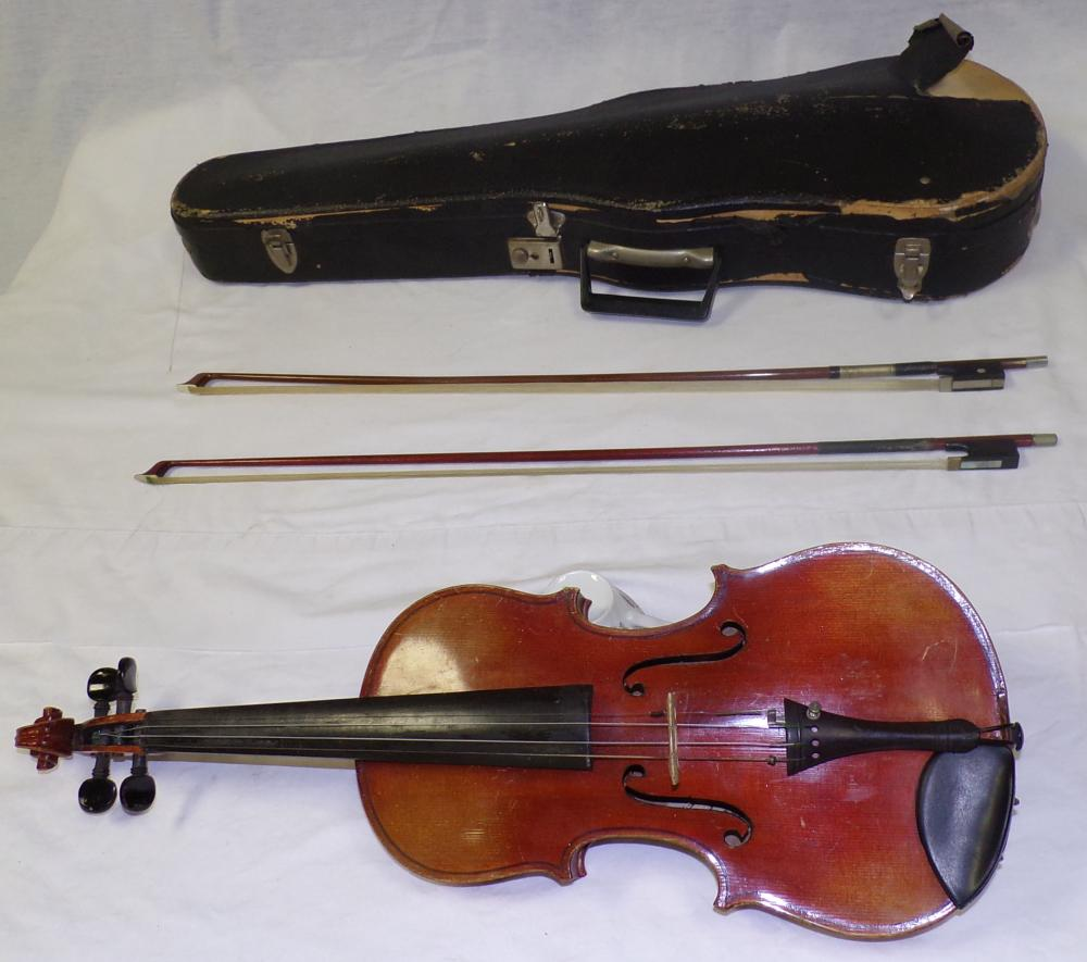 Four string violin with interior paper label written in script reading Stradivarius, together with 2 bows & black case, covering on case is tearing away, bridge not attached to violin, scratches & wear visible on front & back;violin - 22 ½'' L