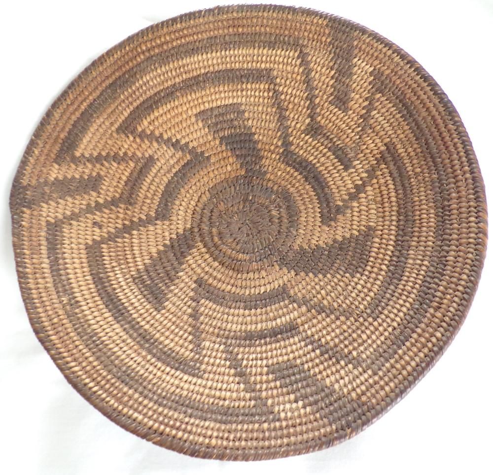 "Native American woven dish form basket, alternating dark & light colors with center ""pinwheel"" design, 1 ¾"" T x 9 ¼"" diameter"