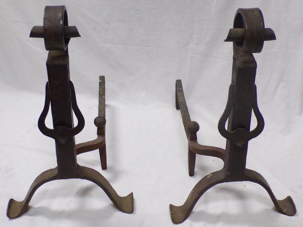 Pair of wrought iron andirons, scrolled design with hinged bell form decoration, each 20 ¼'' T x 12'' W x 21'' D