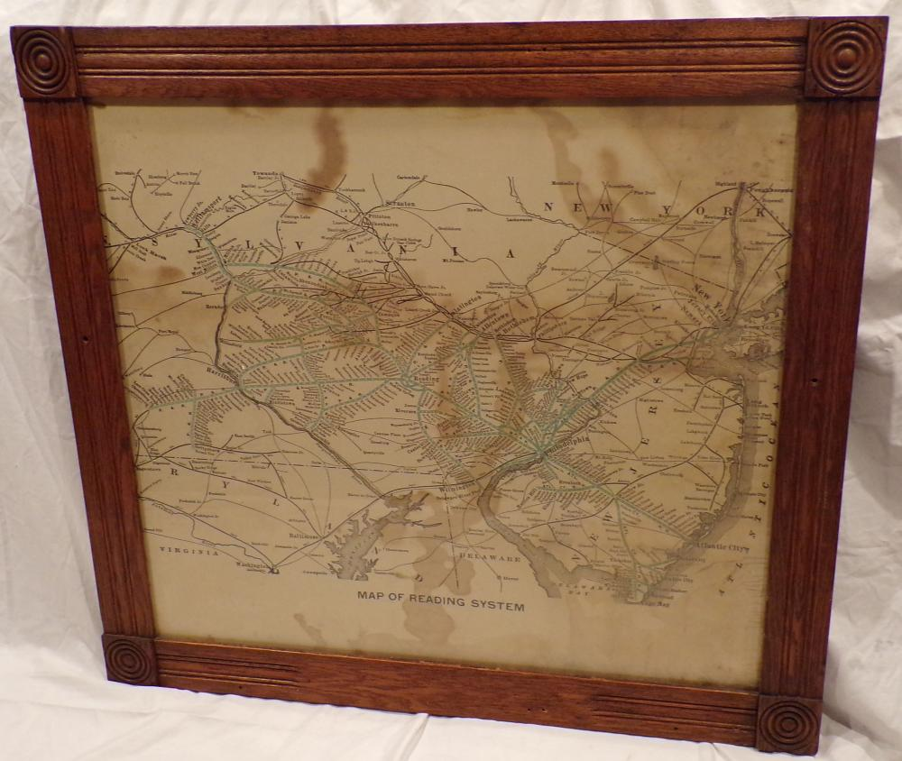 "Vintage railroad map entitled, ""Map of Reading System"", shows foxing, brown staining & discoloration mounted in a late Victorian oak frame with square molded corners, holes drilled on all sides of frame for attachment to wall, 33 ½"" x 36 7/8"""