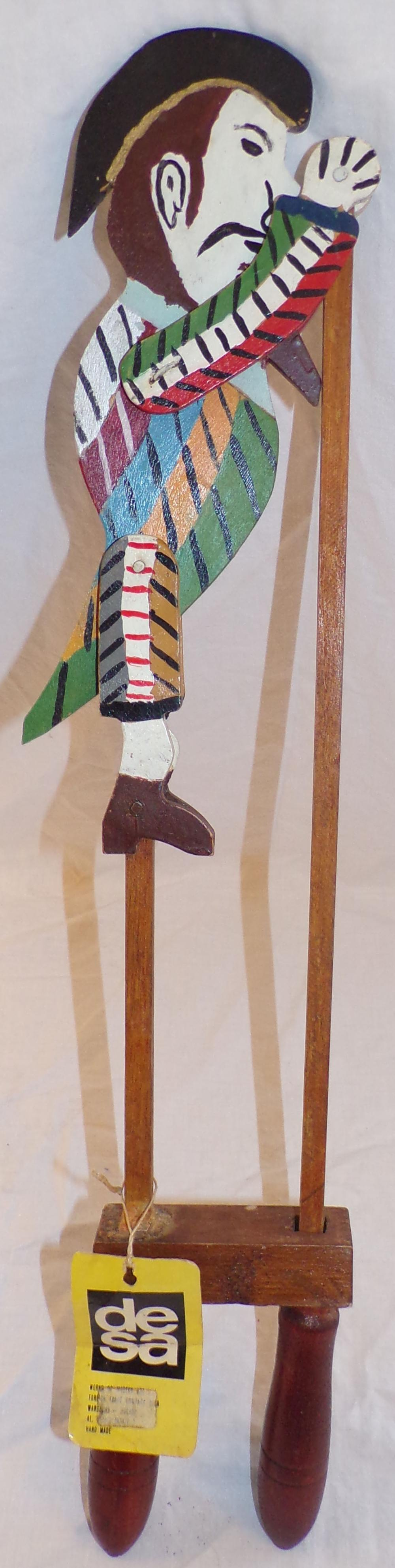 "Handpainted and handcrafted wooden toy, jointed figure of a bearded man with 2 handles adjusting his  position from standing to bending, paper tag attached reading desa, Made In Poland, 22 ½"" L x 4"" W"