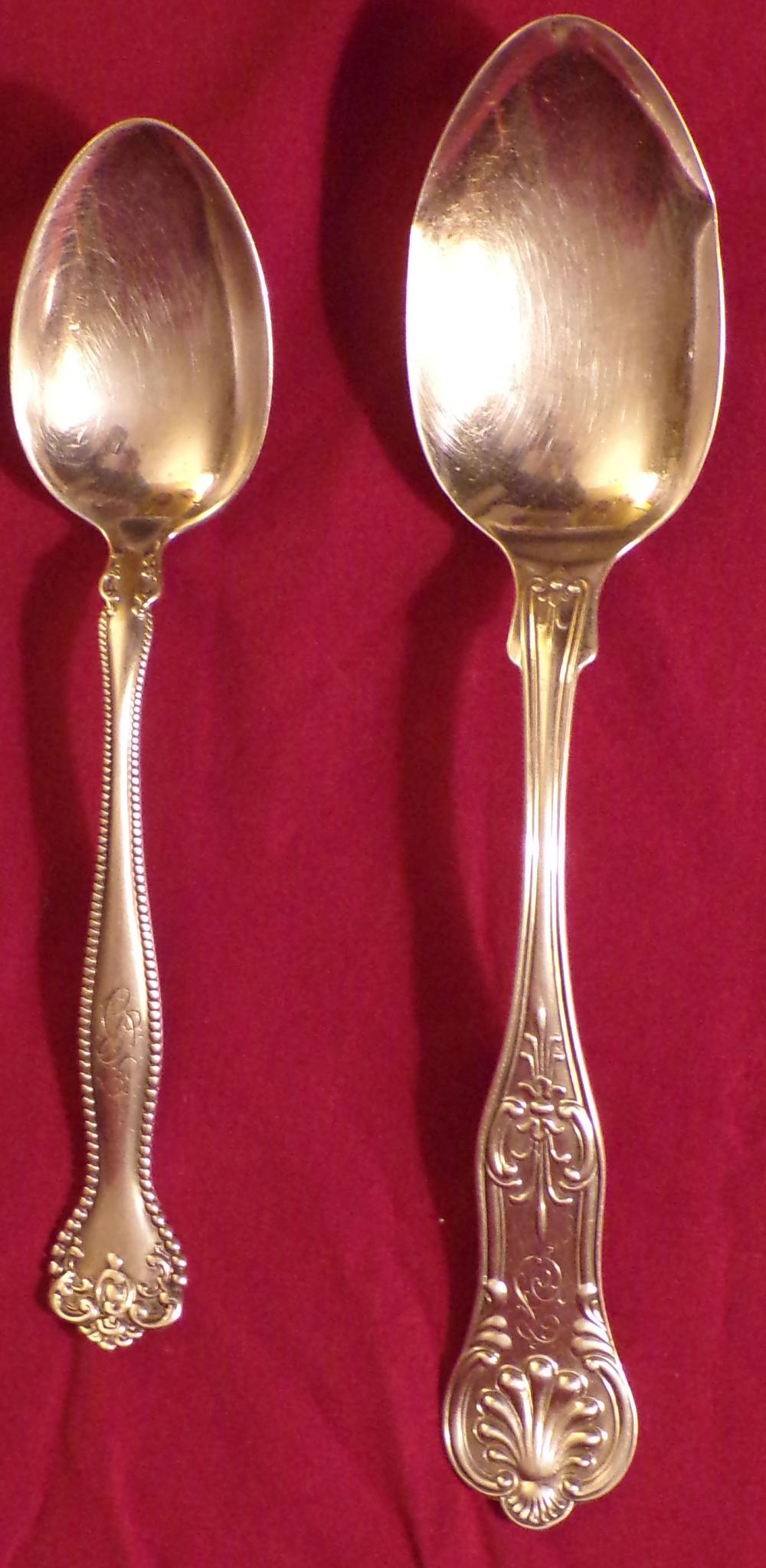 "Two (2) sterling silver flatware pieces including a serving spoon w/shell design, bowl dented, 8 ½"" L AND a  tablespoons w/beaded handle, 7"" L, both monogrammed, approx. 3.21 ozt"