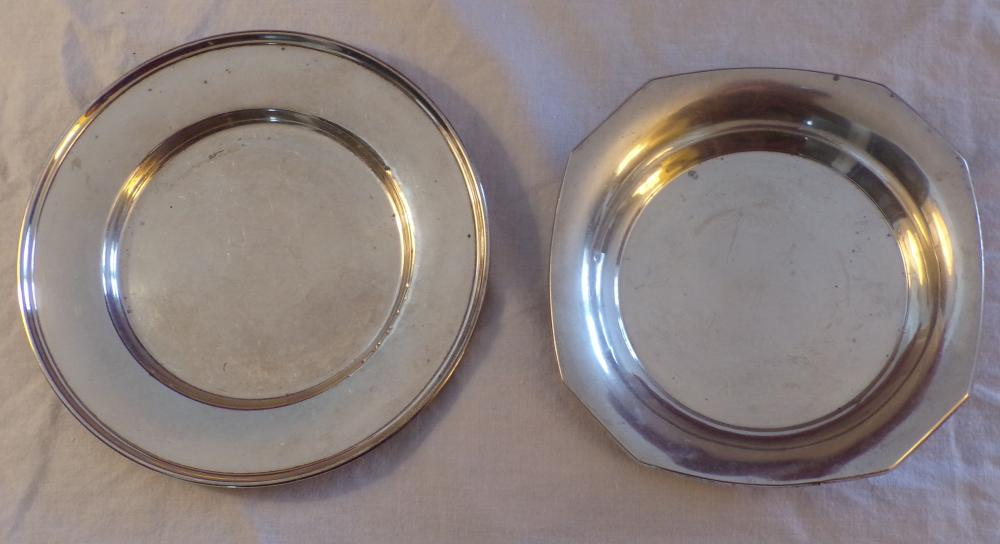 "2 pieces of sterling silver including a small octagonal dish marked J.E. Caldwell & Co., Philadelphia, #3953,  surface well scratched & dented, 5 ¾"" square AND a small round plate, #1508, surface well scratched & dented,  6 ½"" diameter, both pieces AS IS"