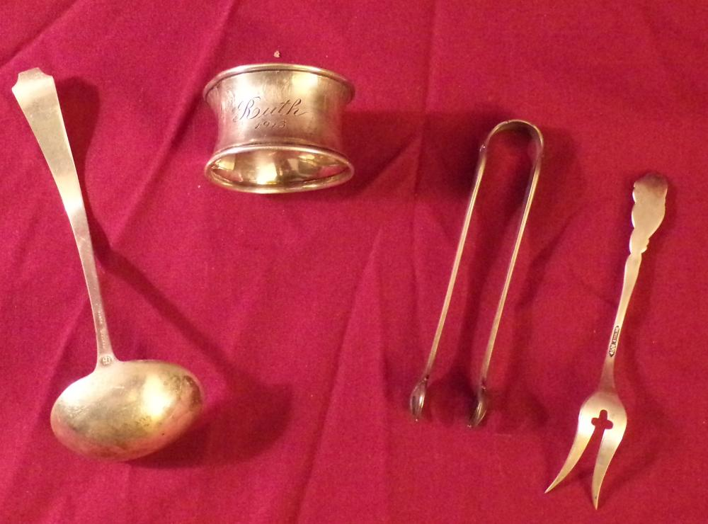 "Grouping of sterling silver including a small lable by Durgin, 5"" L; a small 2 pring fork, 4 ¼"" L AND a napkin ring marked Edith, 1913, dented, 1 ¾"" diameter; approx. 2.05 ozt"