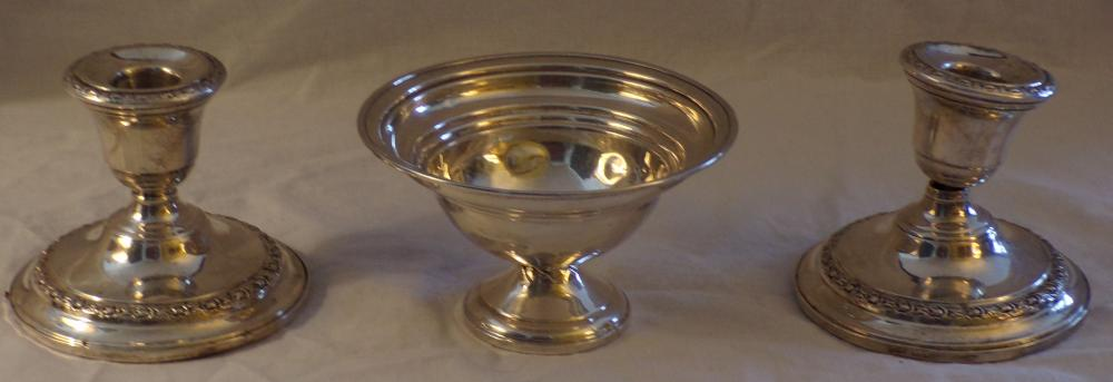 "3 sterling silver pieces including a small round candy dish marked National, surfaced dented throughout,  weighted base, 2 7/8"" T x 5"" top diameter AND 2 matching candlesticks by Frank M. Whiting Co., #259,  Talisman Rose pattern, 1 with top separated from base, both dented, weighted bases, each 3 ¼"" T x 4"" base  diameter, ALL AS IS"