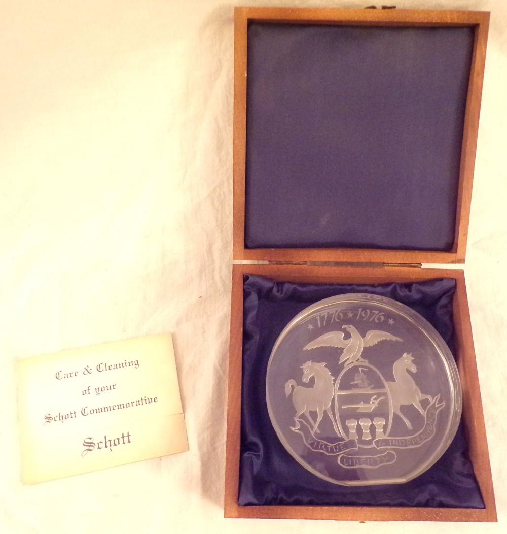 "American Bicentennial crystal commemorative ornament by Schott mounted in a custom made wooden box, #329/500, lid of box has a stain on lid, design on ornament similar but not identical to the Pennsylvania State Seal, 4 ½"" T x 4 ¾"" W; box – 2 7/8"" T x 6"" square"