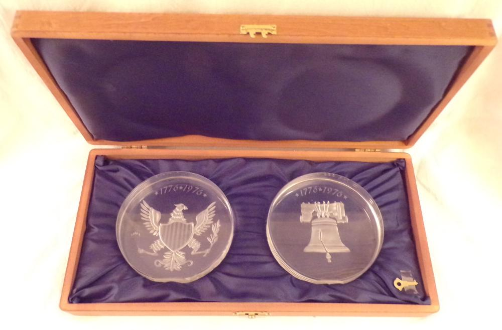 "Set of 4 American Bicentennial (1776-1976) crystal ornaments displayed in 2 custom made wooden boxes;  includes the American Eagle with arrows & olive branch, the Liberty Bell, the American Eagle with Shield -  #17/50 and a Colonial Soldier – 17/50; each ornament – 5 1/8"" T x 5 ¼"" W; each box 2 ½"" T x 15 1/8"" W x  7 5/8"" D, 1 box lid with scratched top"