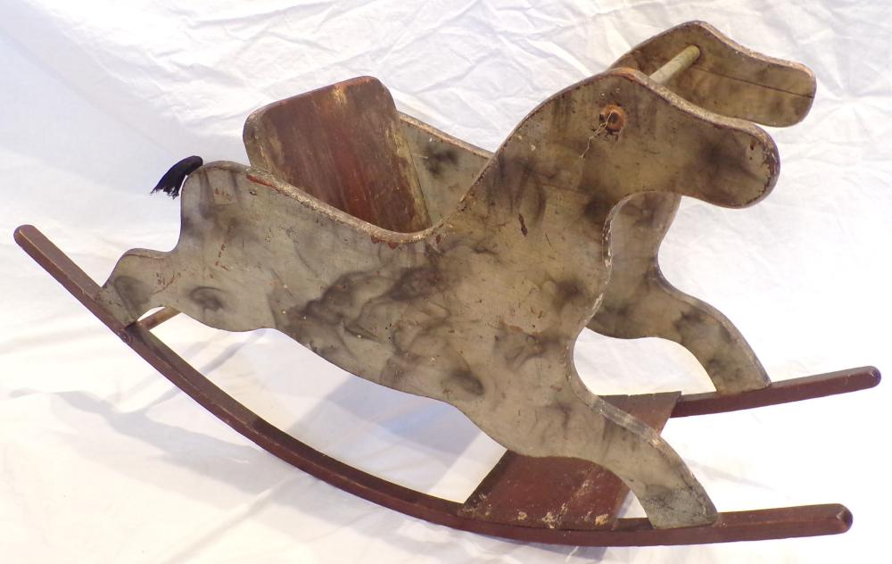 "Antique wooden rocking horse, gray & black painted design with brownish/red painted runners, shows old wear, paint loss & chipping throughout, 21 ¼"" T  38 ¾"" L x 12 7/8"" W"