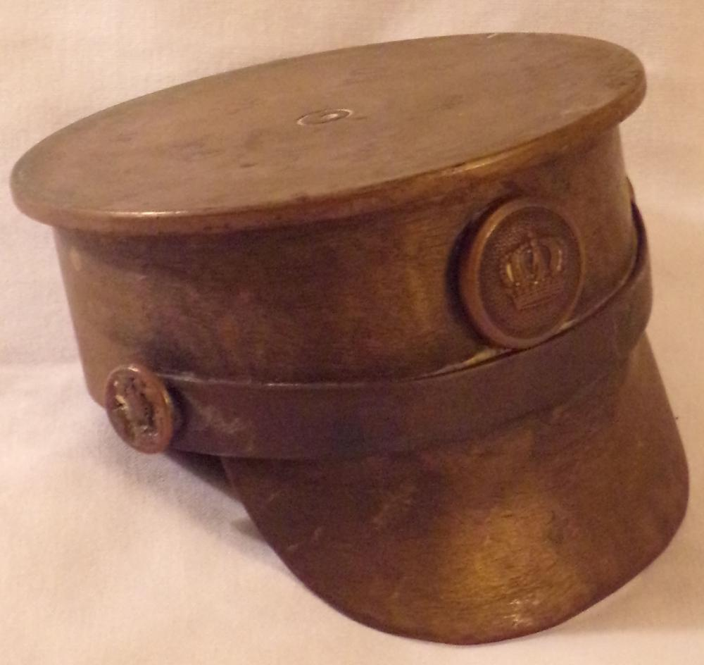 "Vintage WWI brass shell art military uniform visor hat form ashtray, center crown mark insignia, marked Juni 1917,  St, GFSP, 338, Sn 197, 2 5/8"" T x 3 ½"" diameter"