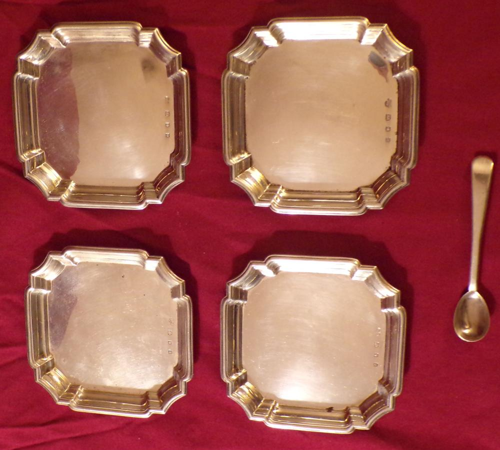 "Four (4) small matching octagonal English silver dishes, all with touchmarks, marked Goldsmiths & Silversmiths  Company, 112 Regent Street W, each 3 ½"" square AND an English silver salt spoon marked WC with touchmarks,  3 ¼"" L, approx. 6.39 ozt"