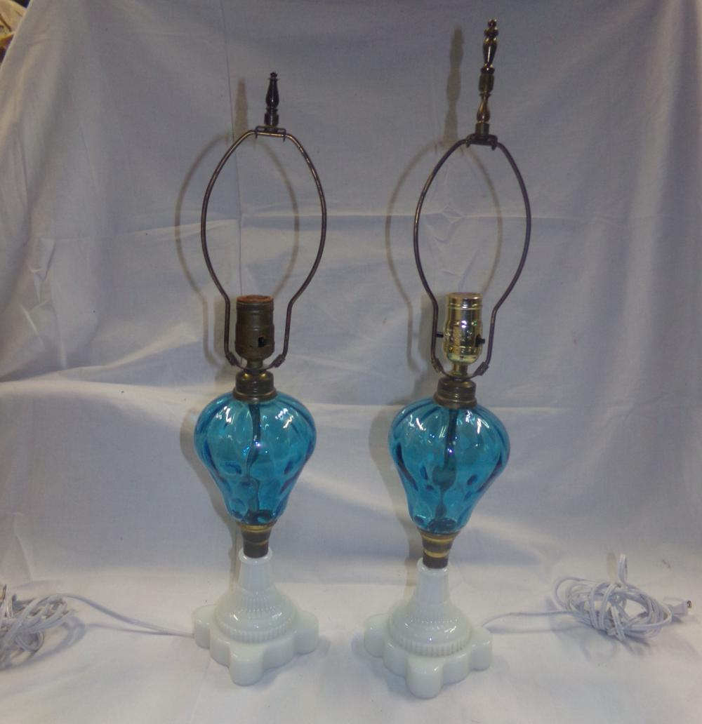 "Pair of Victorian oil lamps each having blue inverted pear shape glass fonts on milkglass bases, electrified, original lamp height each 11 3/8""; bases 4"" square"