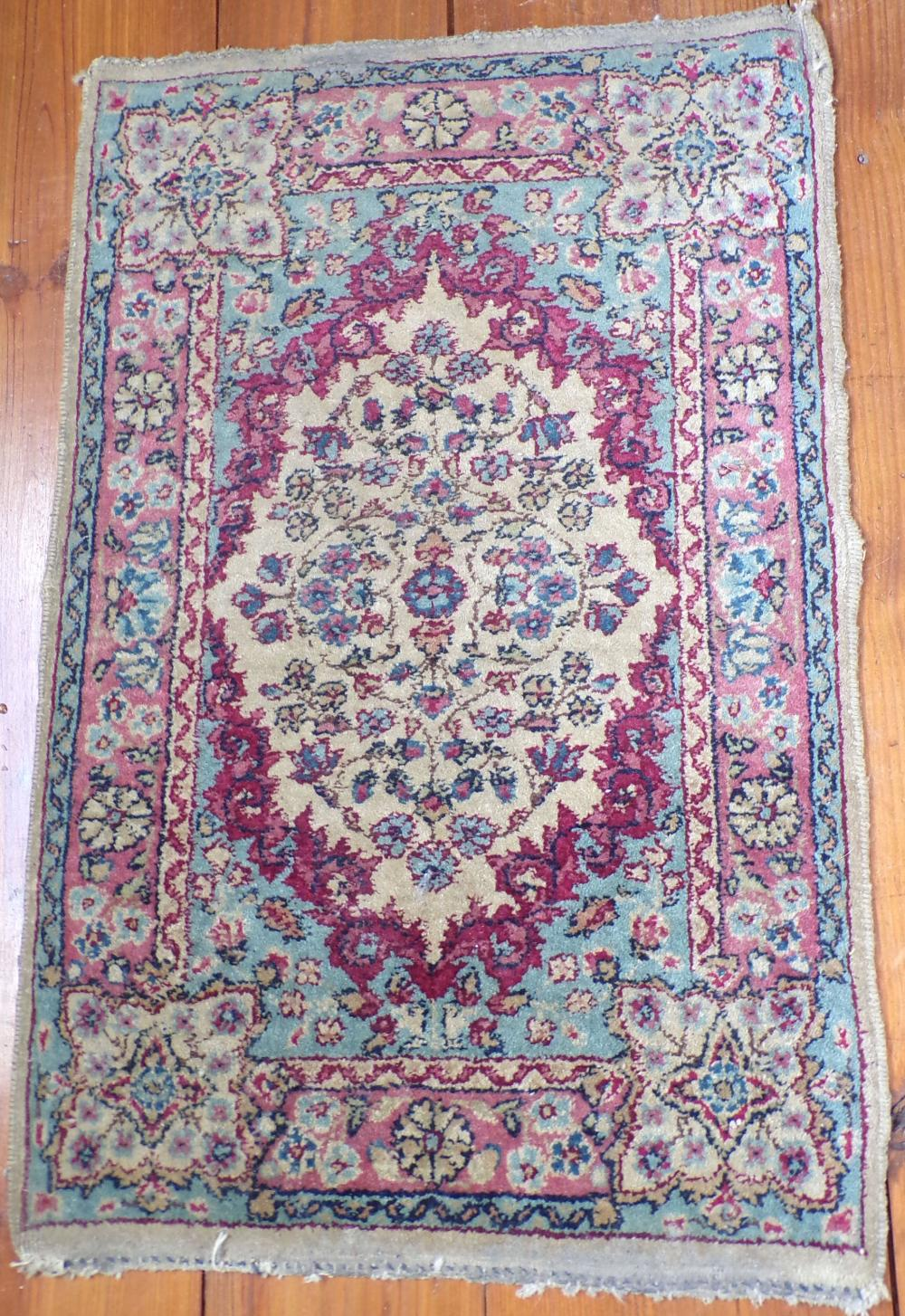 "Small Kirman mat, 16 ½"" x 25"""