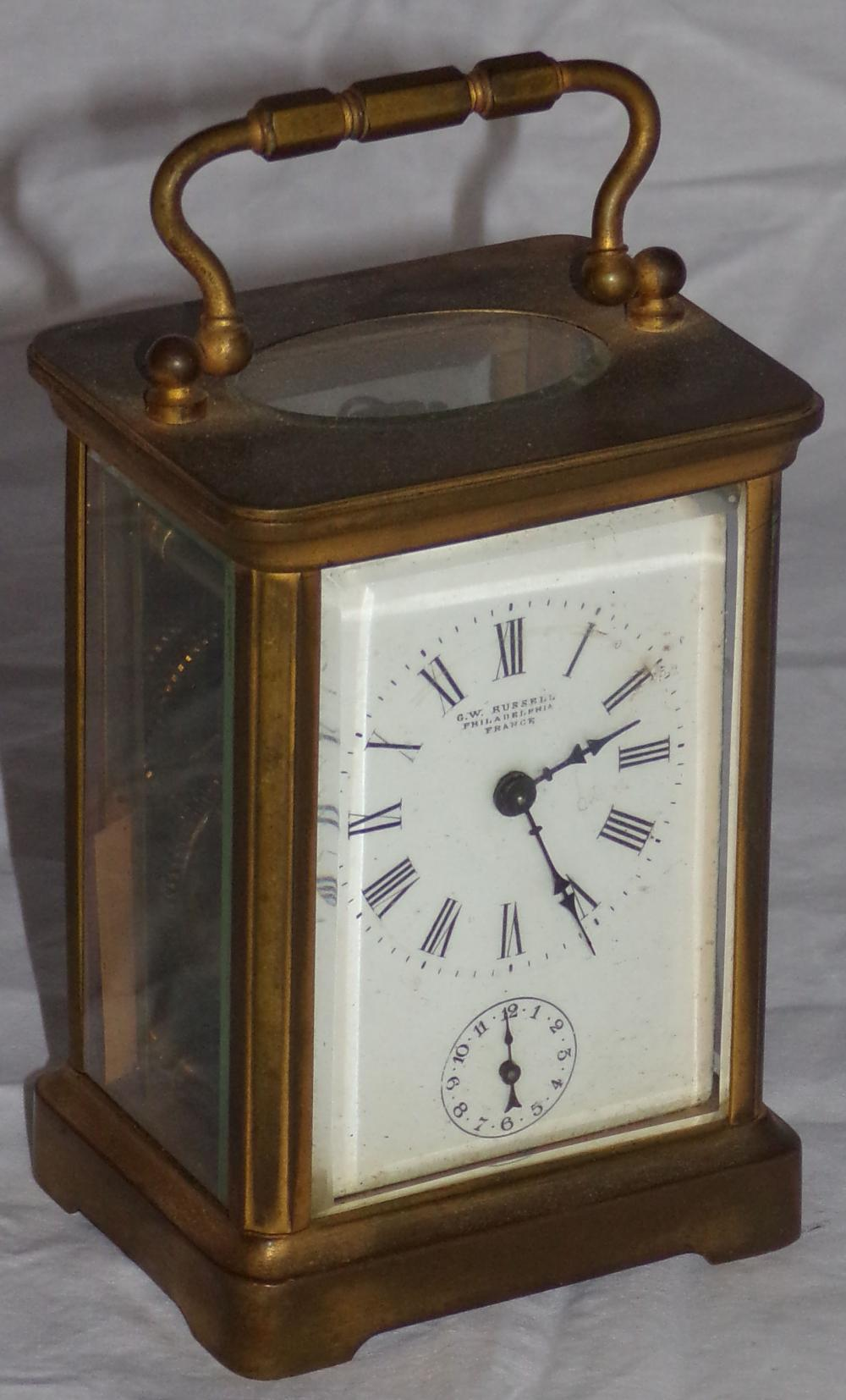 Vintage carriage clock with brass case & beveled glass side & back panels, French movement marked H &H, marked G.W. Russel, Philadelphia on dial