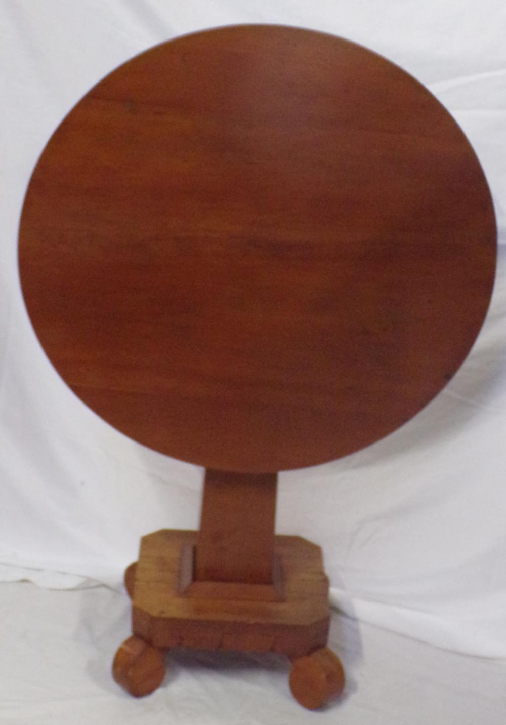 19th century Empire tilt top table having a round top