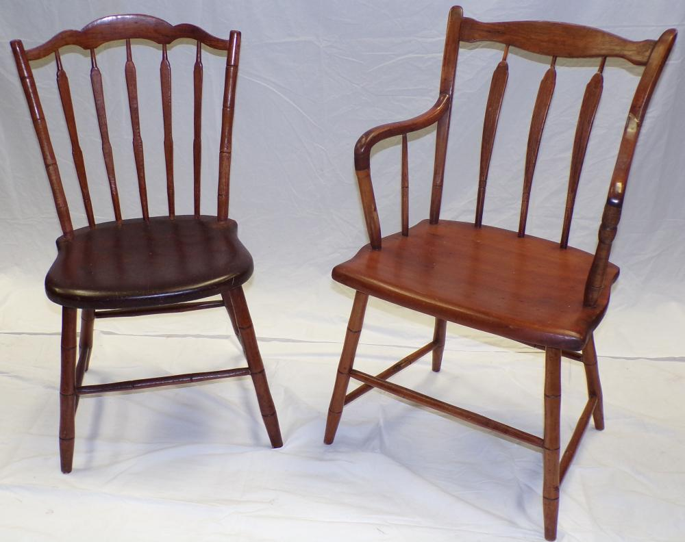 19th century plank seat arrowback chairs including an arm chair
