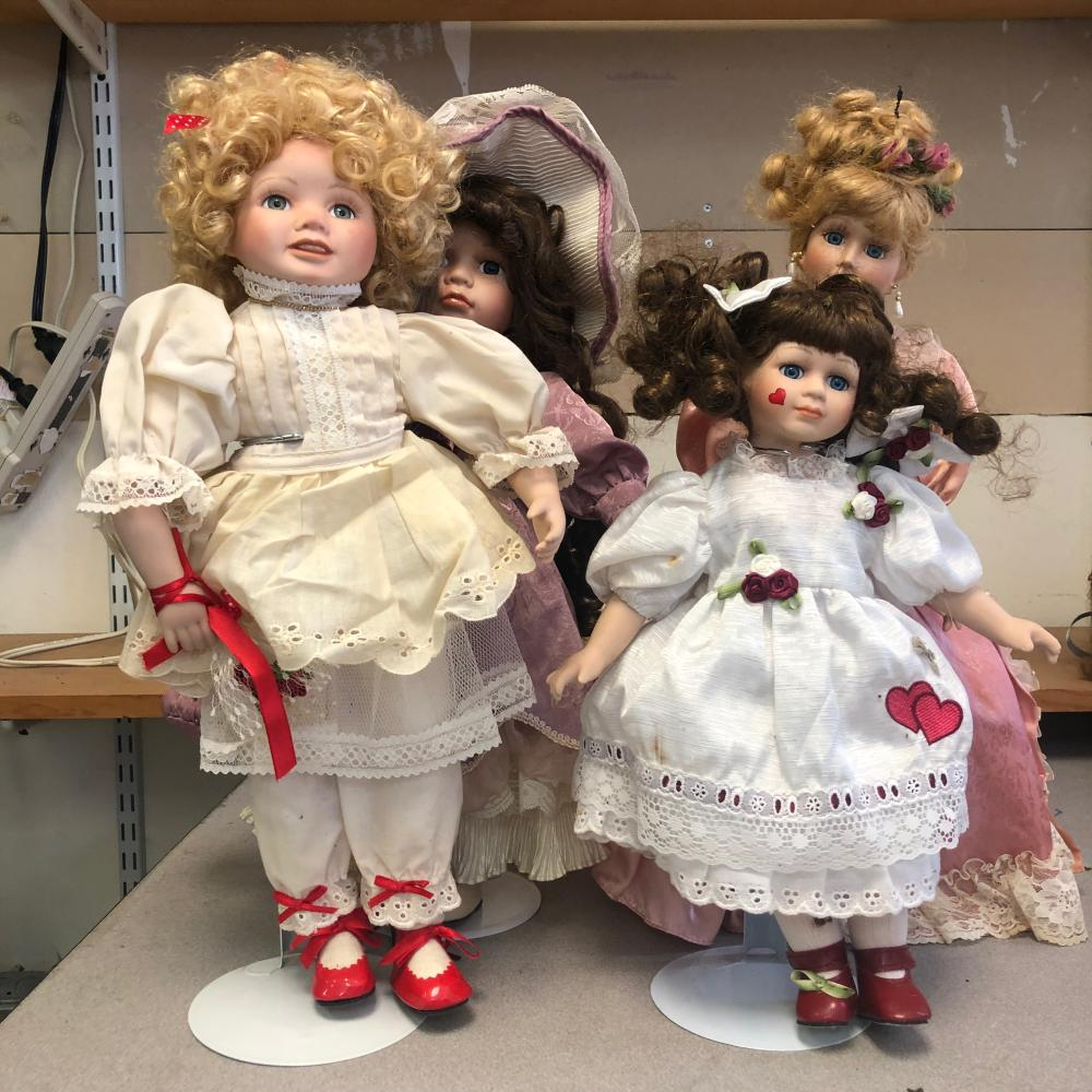 4 Porcelain Dolls With Stands