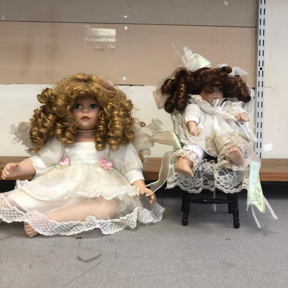 2 Porcelain Dolls , One in Wood Chair