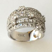 Silver tone wide ring with prongs set and pave set white Czs