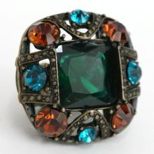 Bronze color big cushion shape with rhinestones and emerald color square faceted stone in the center stretchable ring