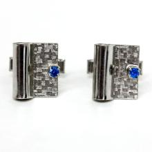 Silver tone textured rectangular cufflinks with prongs set blue sapphire color faceted stone