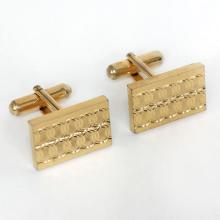 Gold plated rectangular cufflinks with diamond cut design on front