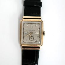Vintage rectangular solid 14k yellow gold MANDYK watch with diamond? dial and black genuine leather strap