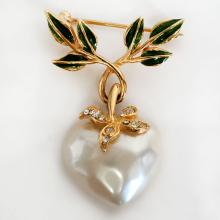 Gold plated enameled white rhinestones pin brooch with dangling faux white heart shape MOP, signed JOAN RIVERS