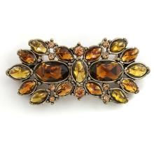 Gold plated pin brooch with checkerboard cut brown, orange and lemon color rhinestones, signed MONET