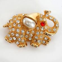 Gold plated ELEPHANT shape pin brooch with rhinestones and faux mother of pearl