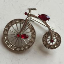 Silver tone BICYCLE WITH MOVING WHEELS shape pin brooch with white and red rhinestones