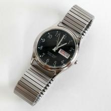 Silver tone round men's OTTIMO Quartz DayDate watch with stretchable bracelet