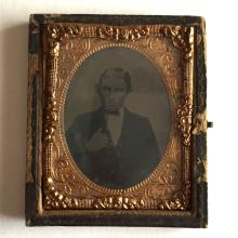 Antique circa 1850-1860 Ambrotype 1/9th (glass positive with black backing) picture of MAN IN SUITE in photo case embellished with foil