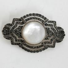 Sterling silver brooch with round white mother of pearl cabochon and marcasites