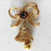 Gold plated brooch pin in shape of bell and bow with rhinestones on the top