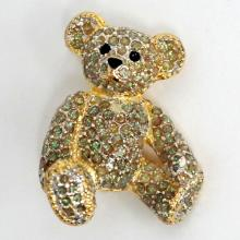Gold plated BEAR shaped brooch with black enamel, rhinestones and green glittering