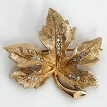 Gold plated textured LEAF shaped brooch with white rhinestones