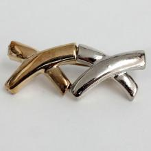 Gold plated and silver tone XX shaped brooch