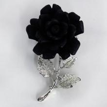 Silver tone textured stem and leaves with black carved resin in shape of ROSE brooch