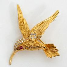 Gold plated textured FLYING BIRD shaped brooch with rhinestones