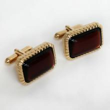 Gold plated cufflinks with rectangular shape garnet color cabochons