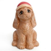 Hand painted porcelain statuette figurine in shape of brown DOG in red hat