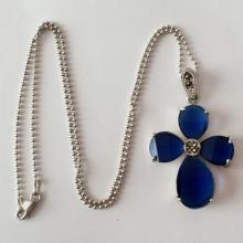 Sterling silver toilet chain and cross shaped pendant with step cut blue sapphire color prongs set stones