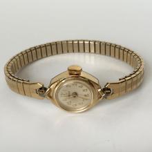 Vintage ladies TIMEX round watch with original stretchable bracelet